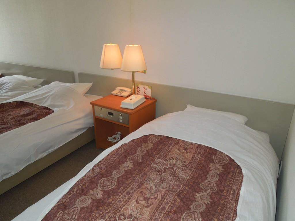 大江戸温泉物語箕面観光ホテルのベッド